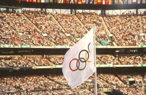 The Olympic flag waves at what would become The Ted. Photo: By Content Providers(s): CDC/Dr. Edwin P. Ewing, Jr. [Public domain], via Wikimedia Commons